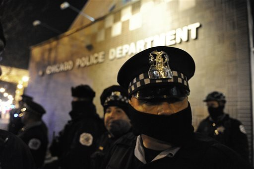Chicago police officers line up outside the District 1 central headquarters at 17th and State streets, Tuesday, Nov. 24, 2015, during a protest for 17-year-old Laquan McDonald, who was fatally shot and killed in October 2014 in Chicago. Chicago police Off