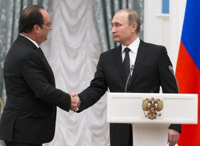Putin and visiting French President Francois Hollande agreed to share intelligence information and cooperate on selecting targets in the fight against the Islamic State group. AP