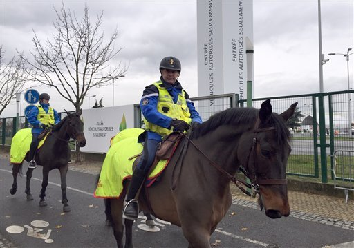Mounted Police officers of the Republican Guar patrol the U.N Climate Conference venue in Le Bourget, outside Paris, Wednesday, Nov. 25, 2015. (AP Photo/Laurent Rebours)
