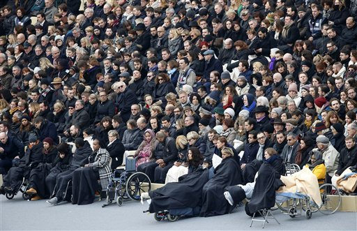Wounded people in the Nov. 13 Paris attacks wait for the start of a ceremony in the courtyard of the Invalides in Paris, Friday, Nov. 27, 2015. (AP Photo/Francois Mori)