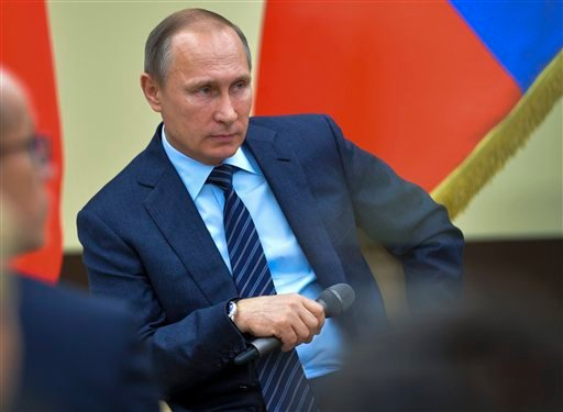"""Russian President Vladimir Putin gestures while listens to a question during a meeting with representatives of """"popular front"""" broad movement at the Novo-Ogaryovo residence outside Moscow, Russia, Friday, Nov. 27, 2015. (Alexei Druzhinin, Sputnik, Kremlin"""