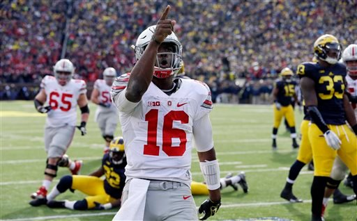 Ohio State quarterback J.T. Barrett (16) points to the crowd after a touchdown during the second half of an NCAA college football game against Michigan, Saturday, Nov. 28, 2015, in Ann Arbor, Mich. (AP Photo/Carlos Osorio)