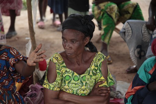 In this photo taken on Wednesday, Nov. 25, 2015, Georgette Dossio sit inside a makeshift tent in Bangui, Central African Republic. (AP Photo/ Lekan Oyekanmi)