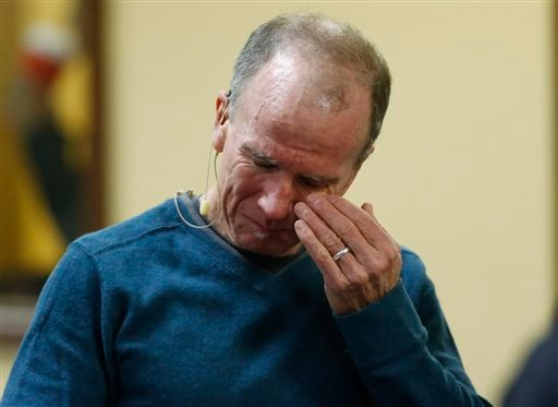 Co-pastor Scott Dontanville of the Hope Chapel fights back tears before taking part in service early Sunday, Nov. 29, 2015, in northeast Colorado Springs, Colo. University of Colorado-Colorado Springs police officer Garrett Swasey, who was one of the thre