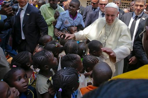 Pope Francis blesses children during his visit at a refugee camp, in Bangui, Central African Republic, Sunday, Nov. 29, 2015. The Pope has landed in the capital of Central African Republic, his final stop in Africa and where he will seek to heal a country