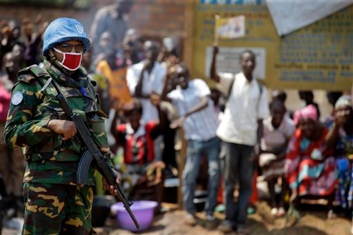 A U.N. peacekeeping soldier patrols the streets prior to the arrival of Pope Francis at a refugee camp, in Bangui, Central African Republic, Sunday, Nov. 29, 2015. The pontiff arrived Sunday in the conflict-torn Central African Republic, brushing aside se