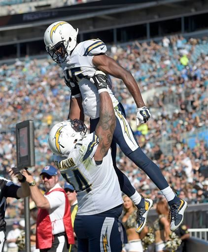 San Diego Chargers wide receiver Dontrelle Inman (15) is lifted by offensive guard Orlando Franklin (74) after Inman scored a touchdown against the Jacksonville Jaguars on a reception during the first half of an NFL football game in Jacksonville, Fla., Su