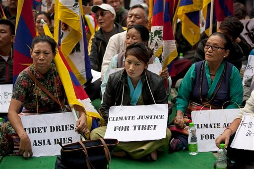 Exile Tibetans sit during a protest ahead of the Paris Climate conference demanding Climate Action for Tibet in New Delhi, India, Sunday, Nov. 29, 2015. The Tibetans are urging world leaders to put Tibet on the global climate change agenda. (AP Photo /Tse