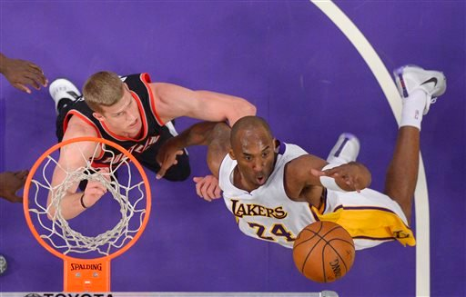 Los Angeles Lakers forward Kobe Bryant, right, grabs a rebound away from Portland Trail Blazers center Mason Plumlee during the first half of an NBA basketball game, Sunday, Nov. 22, 2015, in Los Angeles. (AP Photo/Mark J. Terrill)