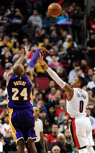 Los Angeles Lakers forward Kobe Bryant (24) shoots over Portland Trail Blazers guard Damian Lillard (0) during the second half of an NBA basketball game Saturday, Nov. 28, 2015, in Portland, Ore. The Blazers won 108-96. (AP Photo/Steve Dykes)