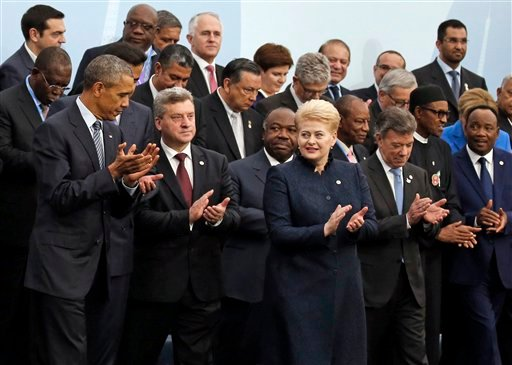President Obama and Brazil's President Dilma Rousseff, front row third from right, pose with world leaders for a group photo at the COP21, United Nations Climate Change Conference, in Le Bourget, outside Paris Nov. 30, 2015.(AP Photo/Jacky Naegelen, Pool)