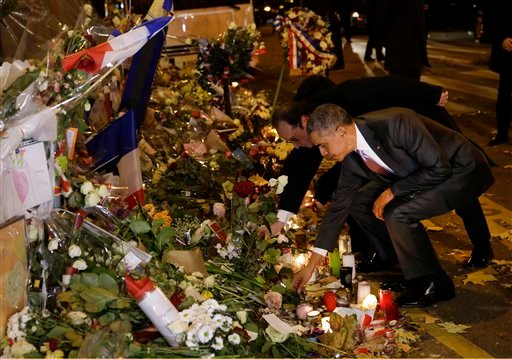 President Obama, French President Francois Hollande pay their respect at Bataclan concert hall, one of the recent deadly Paris attack sites, after Obama arrived to attend the World Climate Change Conference Nov. 30, 2015.(Philippe Wojazer, Pool via AP)