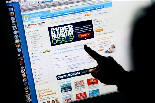 """Nov. 29, 2010, file photo: A consumer looks at Cyber Monday sales on her computer at her home in Palo Alto, Calif. Retailers are rolling out online deals on so-called """"Cyber Monday."""" (AP Photo/Paul Sakuma, File)"""