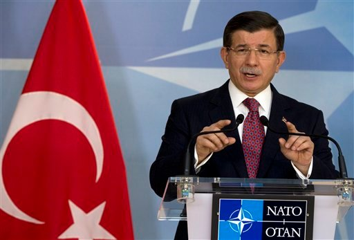 Turkish Prime Minister Ahmet Davutoglu speaks during a media conference at NATO headquarters in Brussels on Monday, Nov. 30, 2015. NATO Secretary General Jens Stoltenberg met with the Turkish prime minister on Monday to discuss the issue of a Russian warp
