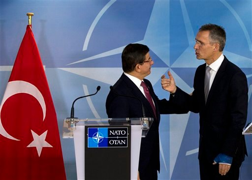 Turkish Prime Minister Ahmet Davutoglu, left, speaks with NATO Secretary General Jens Stoltenberg after addressing a media conference at NATO headquarters in Brussels on Monday, Nov. 30, 2015. NATO Secretary General Jens Stoltenberg met with the Turkish p