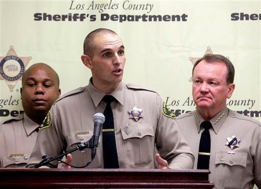 Los Angeles County sheriff's Deputy Adam Collette, who dug an abandoned newborn girl out of a hole, talks during a news conference in Los Angeles, Monday, Nov. 30, 2015. (AP Photo/Nick Ut)