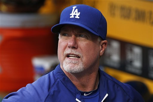 Los Angeles Dodgers batting coach Mark McGwire stands in the dugout efore a baseball game against the Pittsburgh Pirates in Pittsburgh Monday, July 21, 2014.