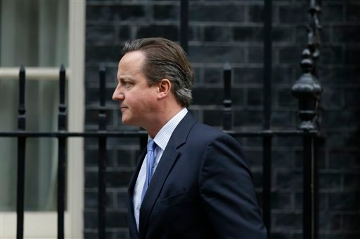British Prime Minister David Cameron leaves 10, Downing Street in London, to go to the Houses of Parliament for a debate and vote on launching airstrikes against Islamic State extremists inside Syria, Wednesday, Dec. 2, 2015. The vote expected Wednesday e