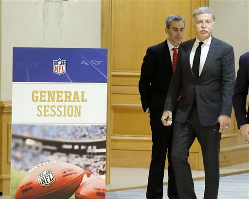 St. Louis Rams owner Stan Kroenke, right, steps outside of an afternoon session at the NFL owners meeting in Irving, Texas, Wednesday, Dec. 2, 2015.