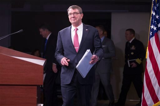 Defense Secretary Ash Carter arrives for a news conference at the Pentagon, Thursday, Dec. 3, 2015, to announce that he has ordered the military to open all combat jobs to women, and is giving the armed services until Jan. 1 to submit plans to make the hi