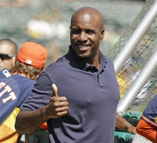 In this Sept. 6, 2014, file photo, career home run leader Barry Bonds gives a thumbs up.