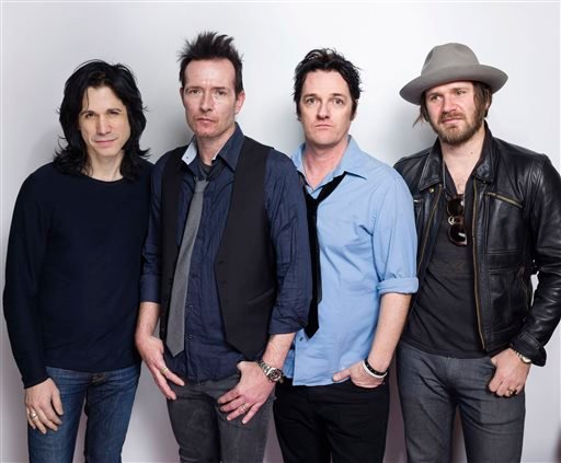 In this Jan. 24, 2015 file photo, Tommy Black, from left, Scott Weiland, Jeremy Brown and Danny Thompson, of The Wildabouts, pose for a portrait at the Eddie Bauer Adventure House during the Sundance Film Festival in Park City, Utah.