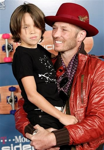 In this Aug. 1, 2008, file photo, singer Scott Weiland, right, and his son Noah Weiland pose on the press line at the T-Mobile Sidekick LX Tony Hawk Edition Party in Los Angeles.