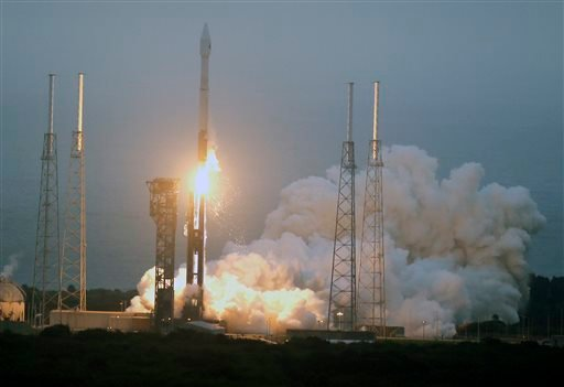 A United Launch Alliance Atlas V rocket lifts off from launch complex 41 at the Cape Canaveral Air Force Station, Sunday, Dec. 6, 2015, in Cape Canaveral, Fla. The rocket is delivering supplies to the International Space Station. (AP Photo/John Raoux)