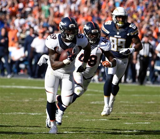 Denver Broncos inside linebacker Danny Trevathan scores on a interception against the San Diego Chargers during the first half in an NFL football game Sunday, Dec. 6, 2015, in San Diego. (AP Photo/Denis Poroy)