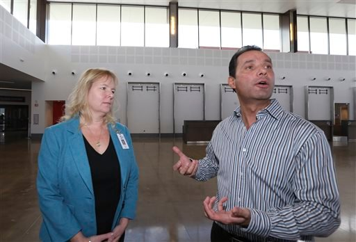 In this Wednesday, Nov. 25, 2015 photo, Enrique Valle, chief executive officer of the Cross Border Xpress air terminal, along with Elizabeth Brown, the chief commercial officer of CBX, talks about the business plans for the terminal in San Diego.