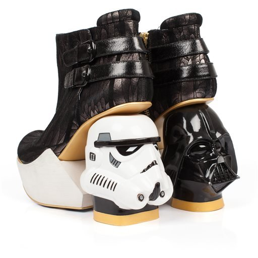 "This photo provided by Disney Consumer Products shows a pair of ankle boots from the unique irregular Choice Star Wars shoe collection. ""Star Wars: The Force Awakens"" opens in U.S. theaters on Dec. 18, 2015, and it's bringing a galaxy of new merchandise w"