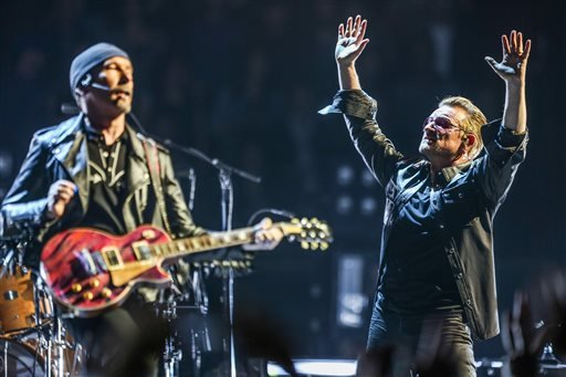In this May 26, 2015 file photo, The Edge, left, and Bono of U2 perform at the Innocence + Experience Tour at The Forum, in Inglewood, Calif.