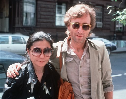In this Aug. 22, 1980, file photo, John Lennon, right, and his wife, Yoko Ono, arrive at The Hit Factory, a recording studio in New York City.