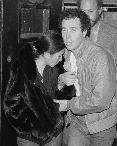 In this Dec. 9, 1980, file photo, Yoko Ono and record producer David Geffen leave Roosevelt Hospital in New York after the death of her husband, John Lennon.