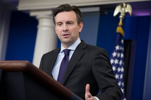 White House press secretary Josh Earnest answers a question about Republican Presidential candidate Donald Trump during the daily press briefing on Tuesday, Dec. 8, 2015, in Washington.