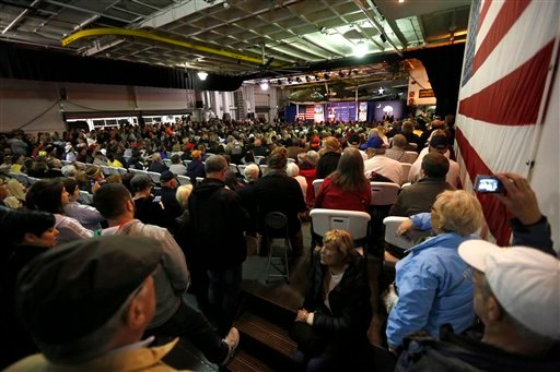 An overflow crowed fills the hangar deck of the USS Yorktown as Republican presidential candidate, businessman Donald Trump, speaks during a rally coinciding with Pearl Harbor Day at Patriots Point aboard the aircraft carrier USS Yorktown in Mt. Pleasant,