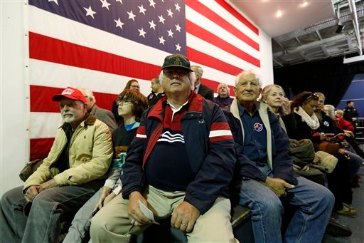 Supporter Erich Schmid, center, from Hilton Head, S.C., waits with other supporters to hear Republican presidential candidate, businessman Donald Trump, speak during a rally coinciding with Pearl Harbor Day at Patriots Point aboard the aircraft carrier US