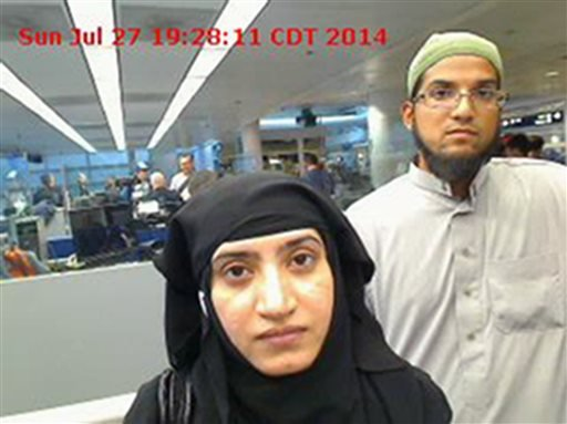This July 27, 2014 photo provided by U.S. Customs and Border Protection shows Tashfeen Malik, left, and Syed Farook, as they passed through O'Hare International Airport in Chicago. The husband and wife died on Dec. 2, 2015, in a gun battle with authoritie
