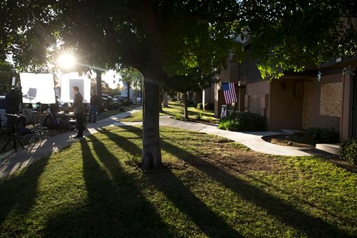 A television reporter stands in front of a townhouse rented by the San Bernardino attackers Syed Farook and his wife, Tashfeen Malik, Tuesday, Dec. 8, 2015, in Redlands, Calif. Just days before he carried out an attack that killed multiple people, Farook