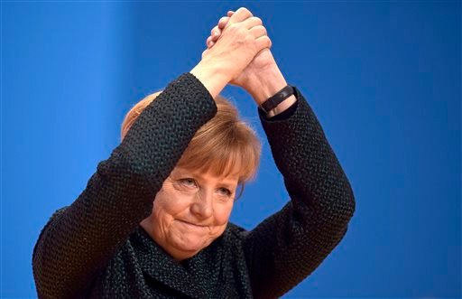 In this Tuesday, Dec. 9, 2014, file photo, German Chancellor and chairwoman of the Christian Democrats, CDU, Angela Merkel, thanks delegates for their standing ovations after her speech at the party convention in Cologne, Germany.