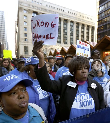 Protesters gather at Chicago's Daley Plaza for a rally and march calling for Mayor Rahm Emanuel and Cook County State's Attorney Anita Alvarez to resign Wednesday, Dec. 9, 2015, in Chicago. (AP Photo/Charles Rex Arbogast)