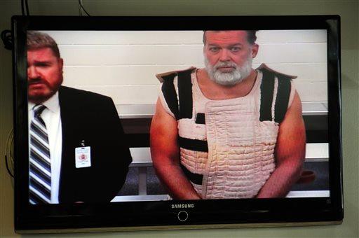Nov. 30, 2015, file photo: Colorado Springs shooting suspect, Robert Dear, right, appears via video before Judge Gilbert Martinez, with public defender Dan King, left for first court appearance. (Daniel Owen/The Gazette via AP, Pool)