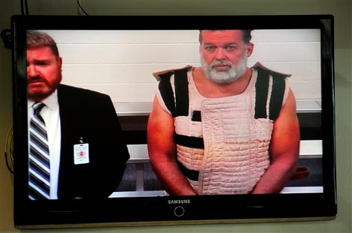 Nov. 30, 2015, file photo: Colorado Springs shooting suspect, Robert Dear, right, appears via video before Judge Gilbert Martinez, with public defender Dan King, left for first court appearance. (Daniel Owen/The Gazette via AP, Pool)