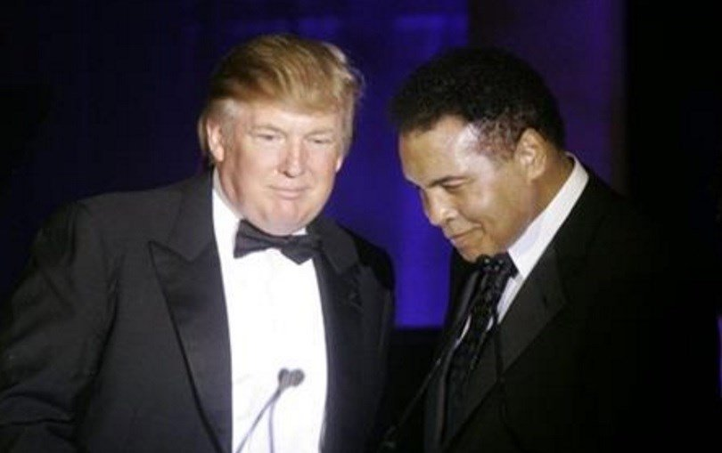 In this March 24, 2007, file photo, Donald Trump, left, accepts his Muhammad Ali award from Ali at Muhammad Ali's Celebrity Fight Night XIII in Phoenix, Ariz. Ali is criticizing Republican presidential front-runner Trump's proposal to ban Muslims . AP