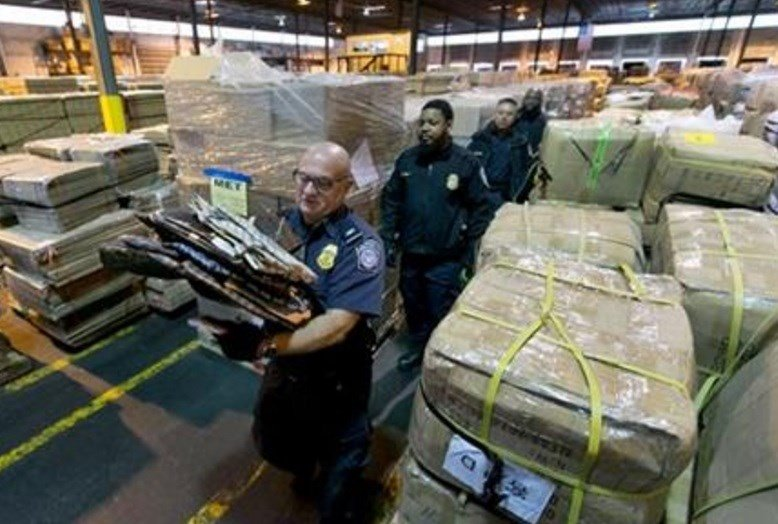 Counterfeiting today is a multibillion-dollar business in China, which produces nearly nine of every 10 fake items seized at U.S. borders. (AP Photo/Richard Drew)