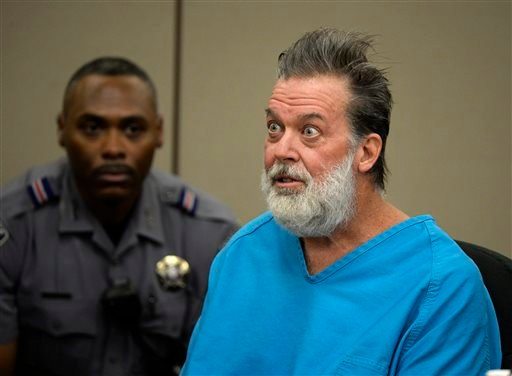 Robert Lewis Dear talks to Judge Gilbert Martinez during a court appearance on Wednesday, Dec. 9, 2015, in Colorado Springs, Colo.