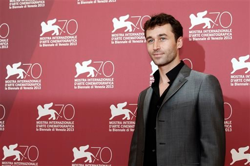 In this Aug. 30, 2013, file photo, actor James Deen poses for photographers at the photo call for the film The Canyons at the 70th edition of the Venice Film Festival in Venice, Italy.