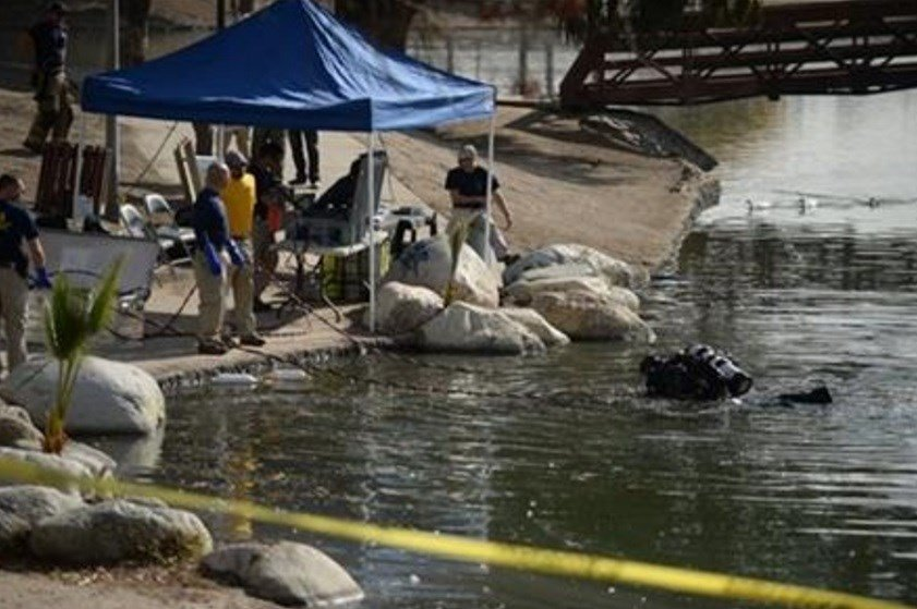 Members of the FBI Underwater Search and Evidence Response Team and bomb specialists work at Seccombe Lake on Thursday, Dec. 10, 2015 in San Bernardino, Calif. (Micah Escamilla/The Sun via AP)