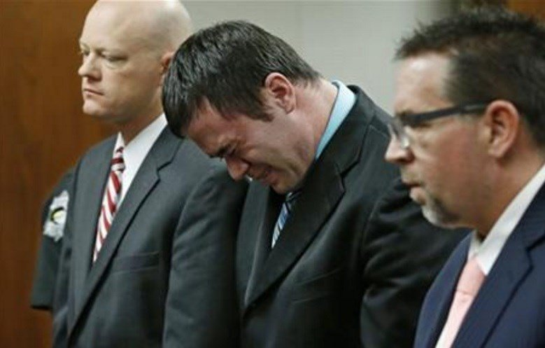 Daniel Holtzclaw, center, cries as he stands in front of the judge after the verdicts were read in his trial in Oklahoma City, Thursday, Dec. 10, 2015. (AP Photo/Sue Ogrocki, Pool)