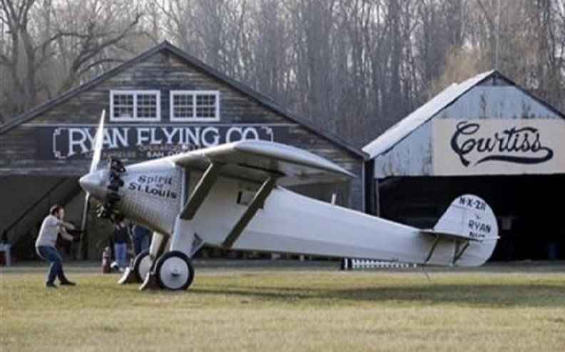 Mark Mondello attempts to hand start a Spirit of St. Louis replica at Old Rhinebeck Aerodrome in Rhinebeck, N.Y. Ken Cassens has spent years creating a doppelganger of the plane Charles Lindbergh flew across the Atlantic in 1927. AP